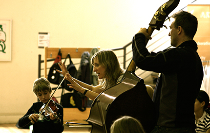 Gillian conducting musicians